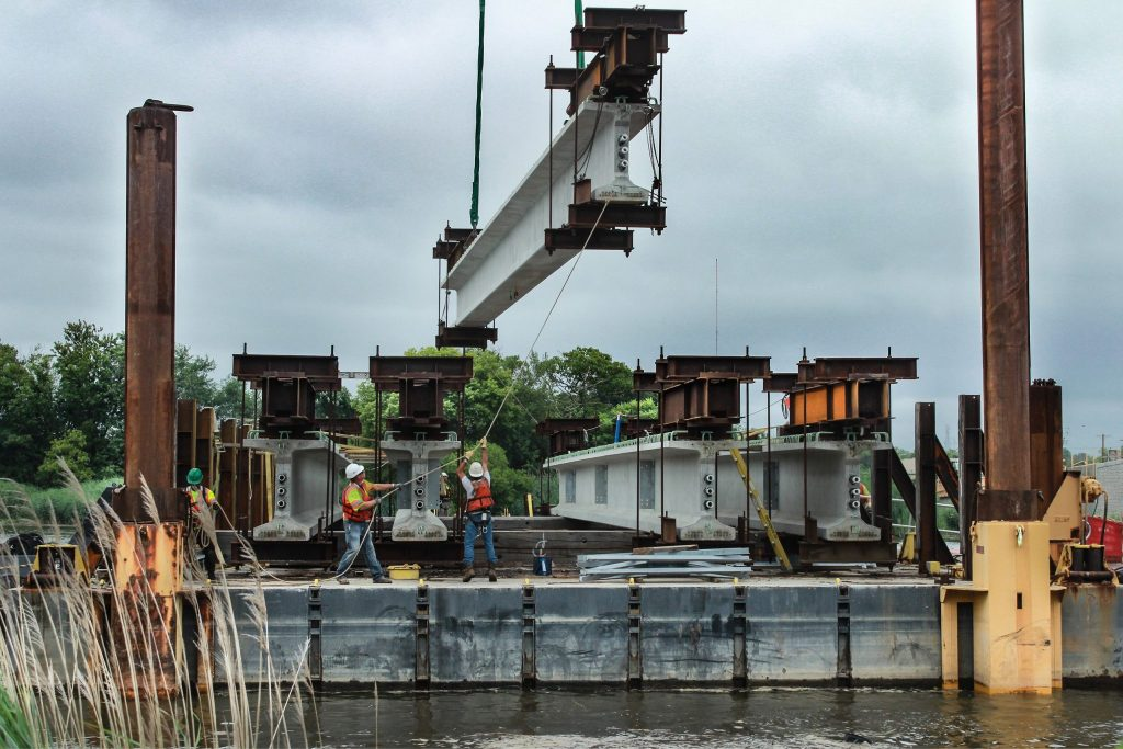 RK&K Team Members Maneuver Crossbeam into place on the Christina River Barge