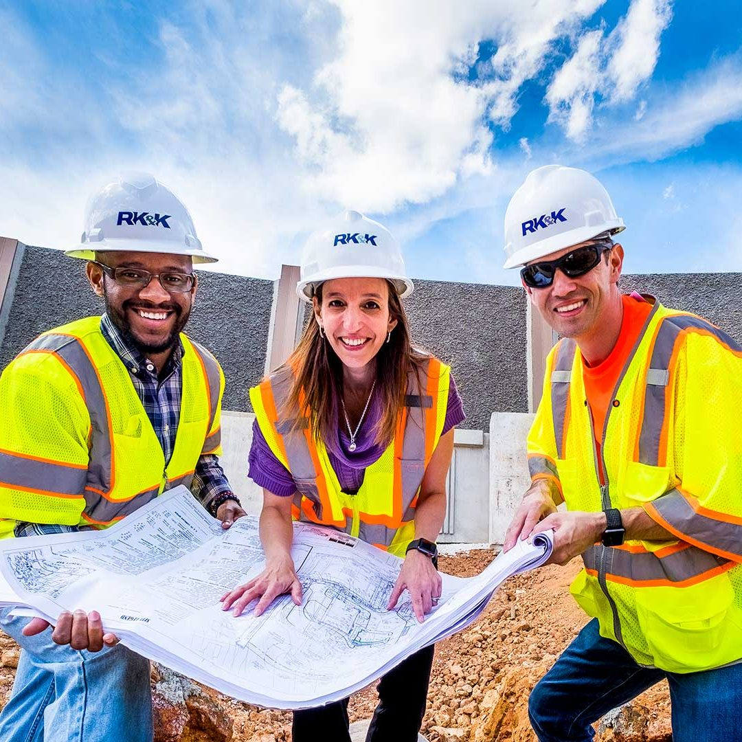 RK&K Team Members at a Construction Site Looking at Engineering Plans