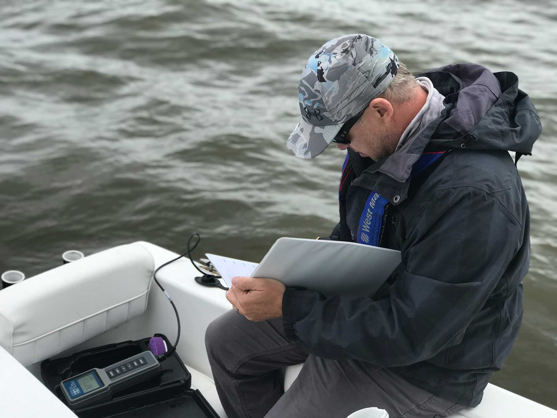 Taking water quality samples for a biological study in North Carolina's Outer Banks.