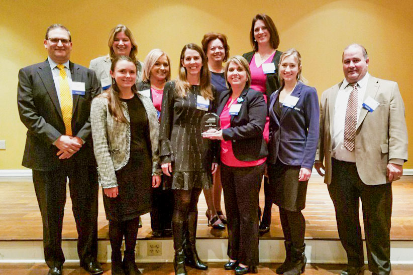 RK&K Team Members pose with the WTS Award for Employer of the Year.