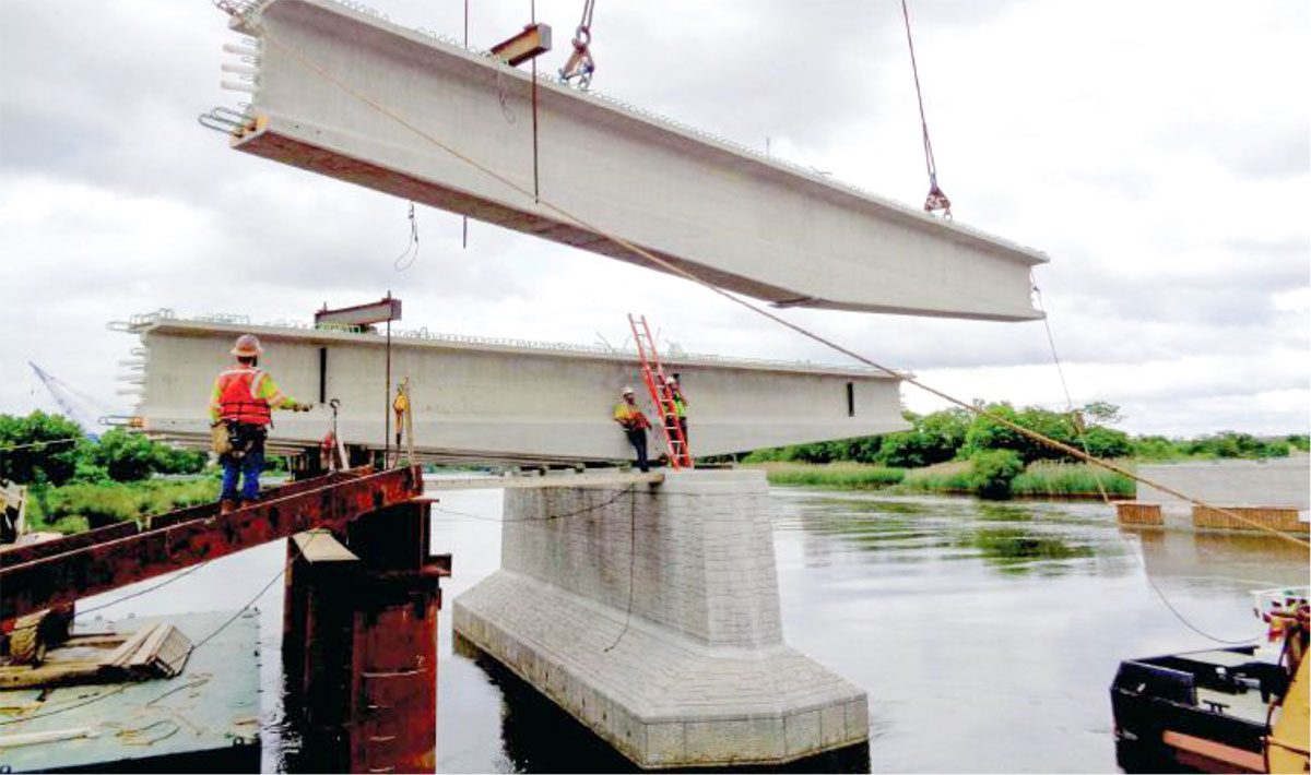 Erection of a haunched pier segment at pier 1 on the Christina River.