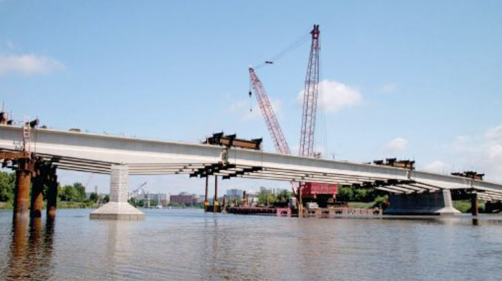 Strongbacks temporarily support Christina River Bridge girder segments