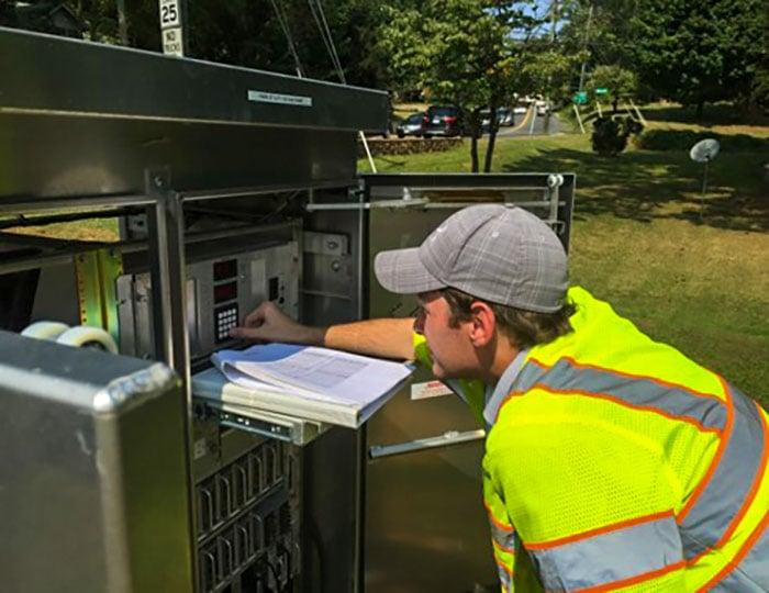 Brian Grandizio working on a signal timing cabinet