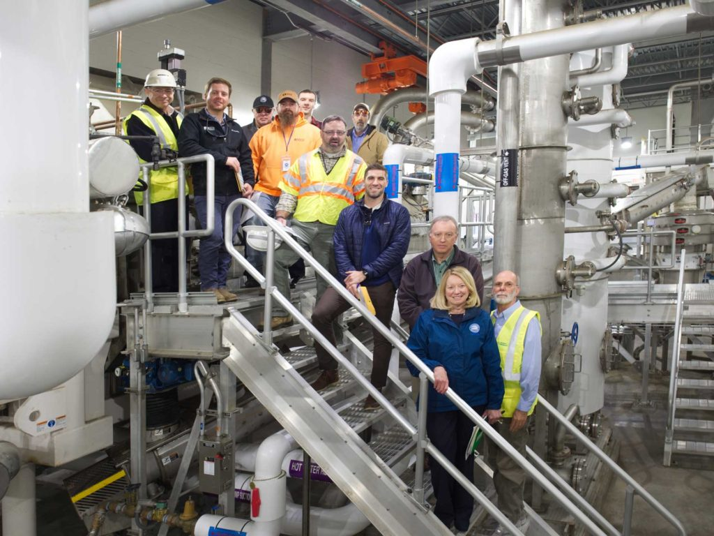 The project team inside the HRRSA biosolids management dryer facility.