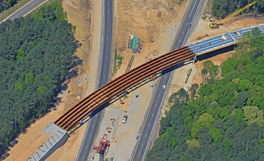 The $360-million design-build project includes 15 new and revamped bridges, including a 1,050-ft-long flyover structure.